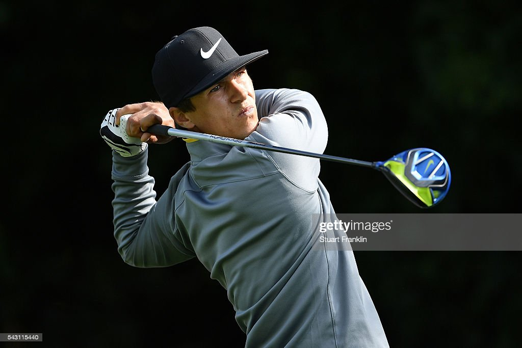 Thorbjorn Olesen of Denmark tees off during the rain delayed third round of the BMW International Open at Gut Larchenhof on June 26, 2016 in Cologne, Germany.
