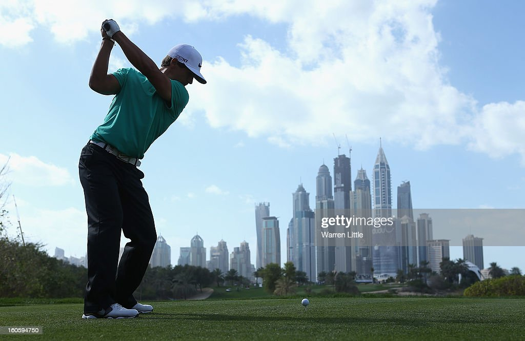 Thorbjorn Olesen of Denmark tees off on the eighth hole during the final round of the Omega Dubai Desert Classic at Emirates Golf Club on February 3, 2013 in Dubai, United Arab Emirates.
