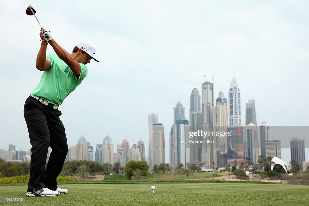 Thorbjorn Olesen of Denmark tees off on the eighth hole during the final round of the 2014 Omega Dubai Desert Classic on the Majlis Course at the...