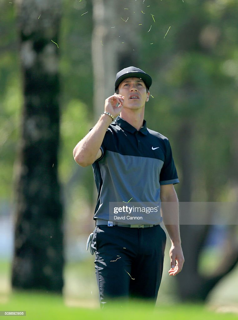 <a gi-track='captionPersonalityLinkClicked' href=/galleries/search?phrase=Thorbjorn+Olesen&family=editorial&specificpeople=6545194 ng-click='$event.stopPropagation()'>Thorbjorn Olesen</a> of Denmark tests the wind on his second shot at the par 4, first hole during the third round of the 2016 Omega Dubai Desert Classic on the Majlis Course at the Emirates Golf Club on February 6, 2016 in Dubai, United Arab Emirates.