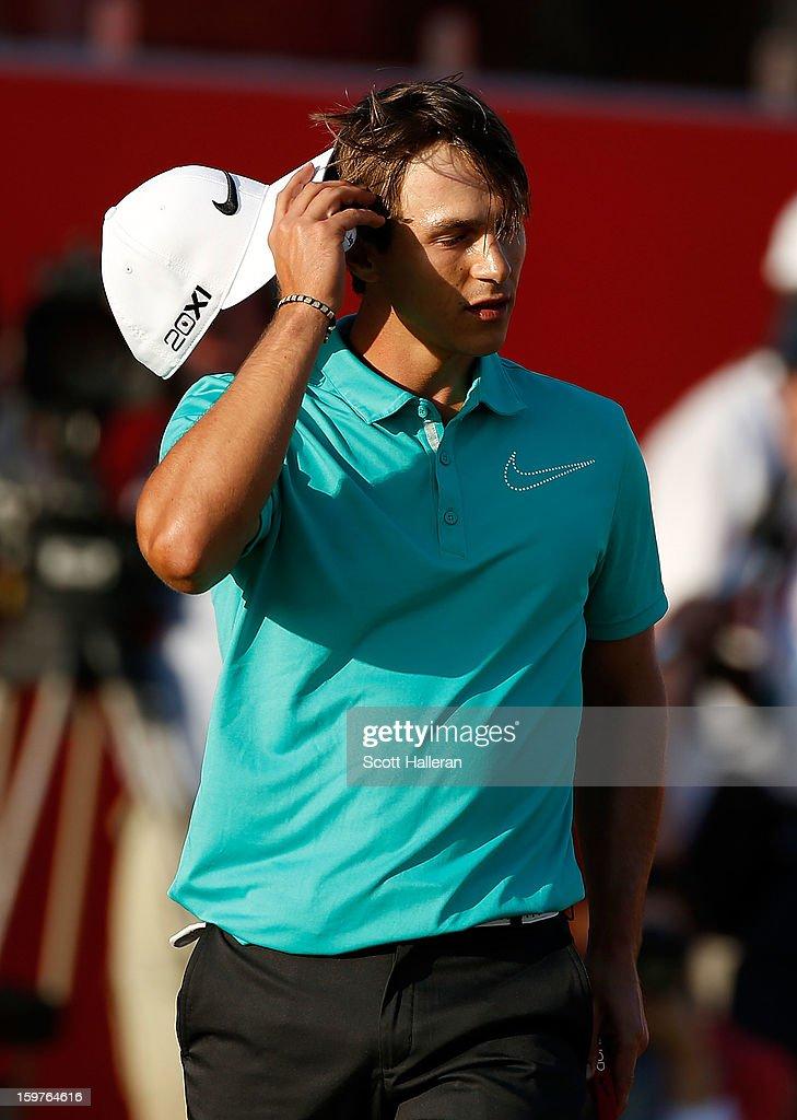 Thorbjorn Olesen of Denmark walks off the 18th green during the final round of the Abu Dhabi HSBC Golf Championship at Abu Dhabi Golf Club on January 20, 2013 in Abu Dhabi, United Arab Emirates.