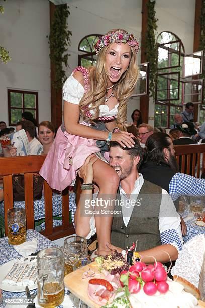 Thore Schoelermann and his girlfriend Jana Julie Kilka during the Oktoberfest 2015 Opening at Hofbraeu beer tent at Theresienwiese on September 19...