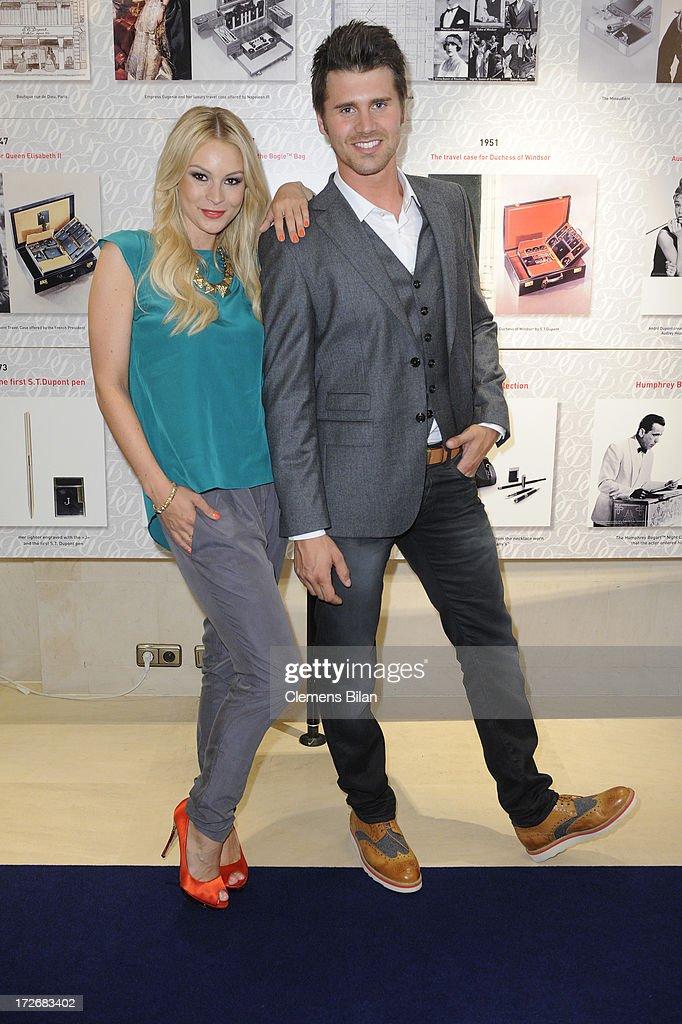 Thore Schoelermann and Jana Julie Kilka attend the Dawid Tomaszewski Show during the Mercedes-Benz Fashion Week Spring/Summer 2014 at Brandenburg Gate on July 4, 2013 in Berlin, Germany.