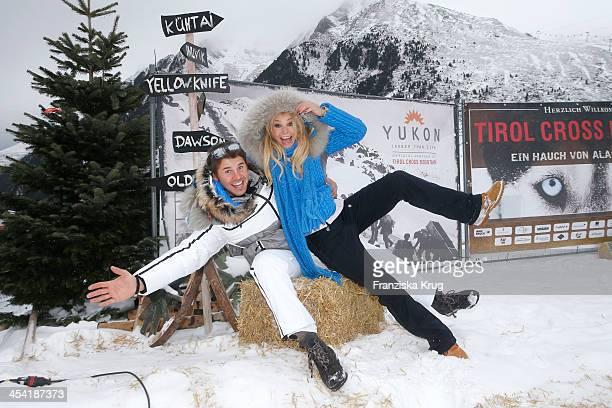 Thore Schoelermann and Jana Julie Kilka attend the Sledge Dog Race Tirol Cross Mountain 2013 on December 07 2013 in Innsbruck Austria