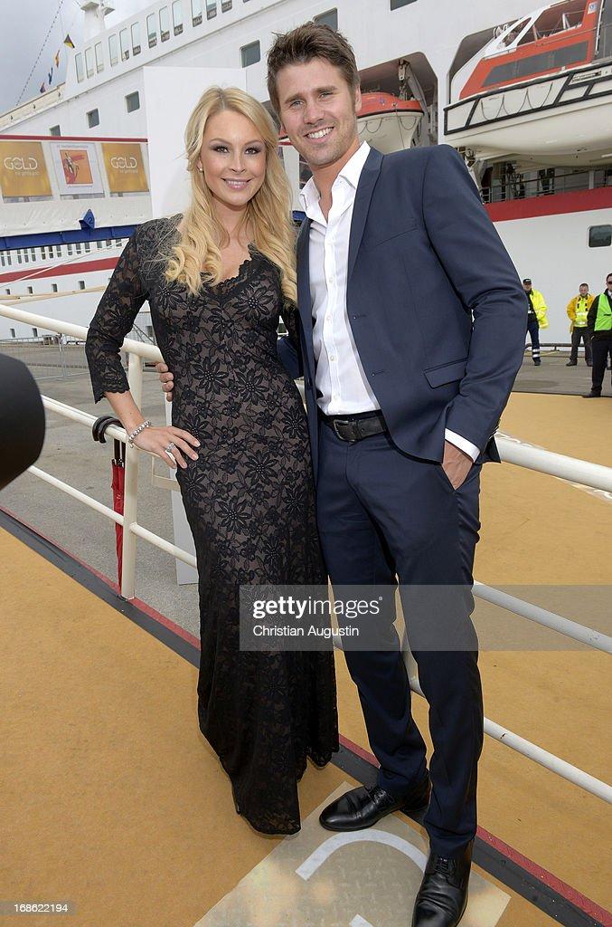 Thore Schoelermann and Julie Kilka attend the charity event 'Die Goldene Deutschland' at MS Deutschland on May 12, 2013 in Hamburg, Germany.