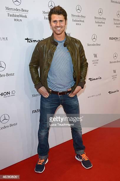 Thore Schoelermann arrives for the Dawid Tomaszewski show during MercedesBenz Fashion Week Autumn/Winter 2014/15 at Brandenburg Gate on January 15...