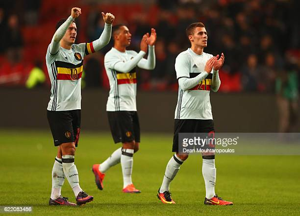 Thorgan Hazard and Eden Hazard of Belgium applaud the travelling fans after the international friendly match between Netherlands and Belgium at...