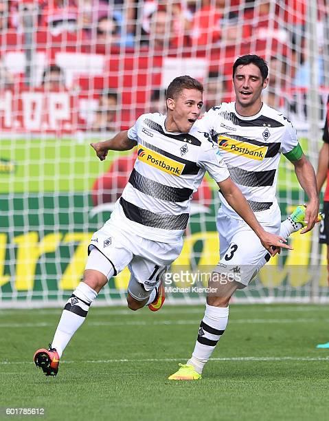 Thorgan Hazard and Lars Stindl of Borussia Moenchengladbach celebrating Hazards opening goal during the Bundesliga match between Sport Club Freiburg...
