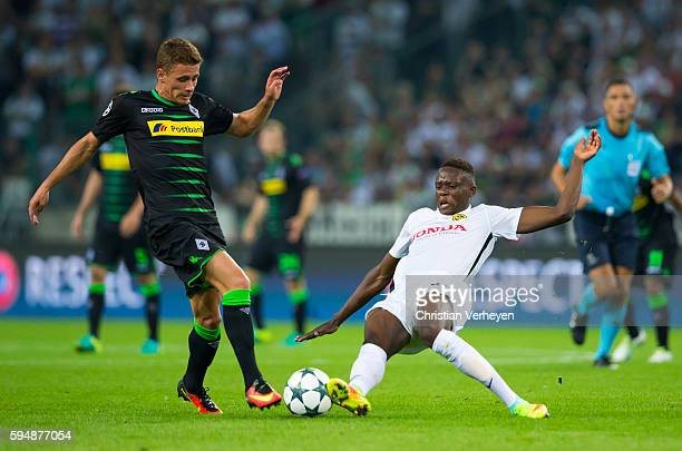 Thorgan Hazard of Borussia Moenchengladbach and Denis Zakaria of Young Boys Bern battle for the ball during the UEFA Champions League Qualifying...