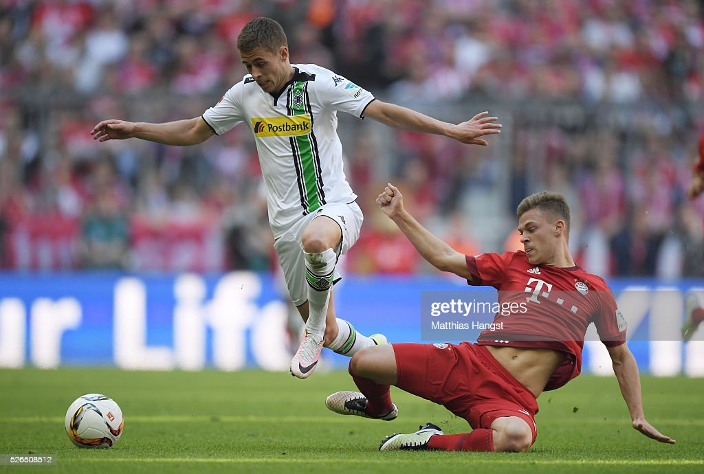 Thorgan Hazard of Borussia Moenchengladbach and Joshua Kimmich of Bayern Muenchen compete for the ball during the Bundesliga match between Bayern Muenchen and Borussia Moenchengladbach at Allianz Arena on April 30, 2016 in Munich, Germany.