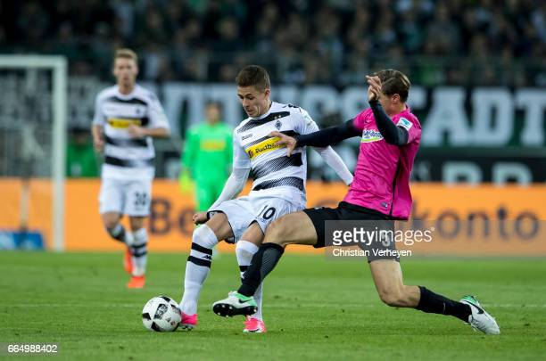 Thorgan Hazard of Borussia Moenchengladbach battle for the ball Niklas Stark of Hertha BSC during the Bundesliga Match between Borussia...