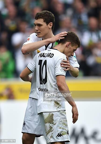Thorgan Hazard of Borussia Moenchengladbach celebrates with Andreas Christensen as he scores their fourth goal during the Bundesliga match between...