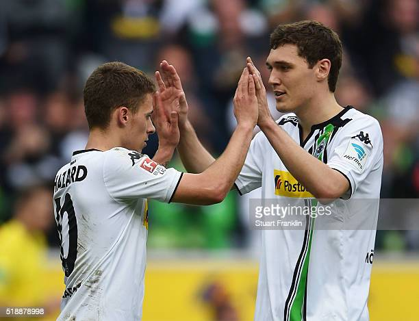 Thorgan Hazard of Borussia Moenchengladbach celebrates with Andreas Christensen as he scores their fourth goal during the Bundesliga match between...