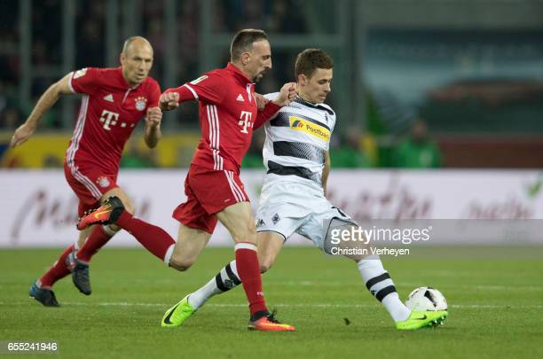 Thorgan Hazard of Borussia Moenchengladbach is chased by Franck Ribery and Arjen Robben of FC Bayern Muenchen during the Bundesliga Match between...