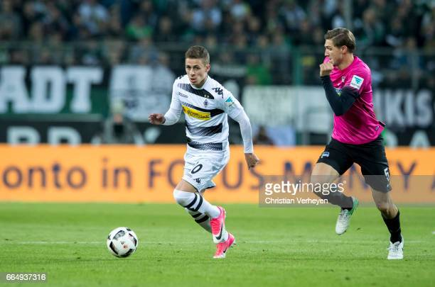 Thorgan Hazard of Borussia Moenchengladbach is chased by Niklas Stark of Hertha BSC during the Bundesliga Match between Borussia Moenchengladbach and...