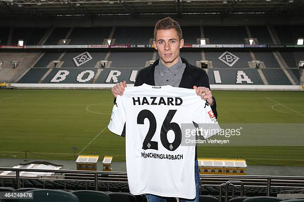 Thorgan Hazard of Borussia Moenchengladbach poses with his shirt as he signs a new contract for Borussia Moenchengladbach on February 23 2015 at...