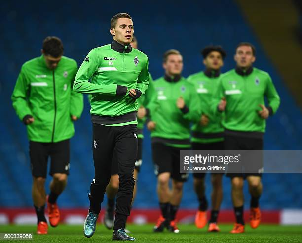 Thorgan Hazard of Borussia Moenchengladbach warms up during a VfL Borussia Moenchengladbach training session prior to the UEFA Champions League match...