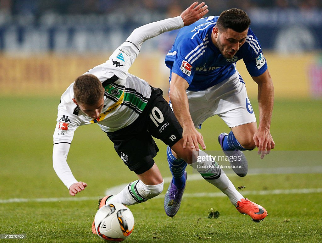 Thorgan Hazard of Borussia Monchengladbach can not get past the tackle from Sead Kolasinac of Schalke during the Bundesliga match between FC Schalke 04 and Borussia Moenchengladbach held at Veltins-Arena on March 18, 2016 in Gelsenkirchen, Germany.