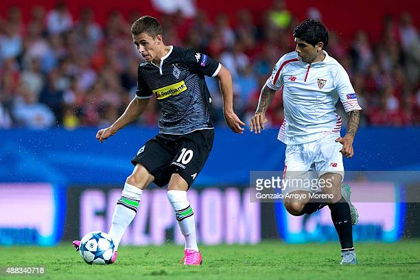 Thorgan Hazard of Borussia Monchengladbach competes for the ball with Ever Banega of Sevilla FC during the UEFA Champions League Group D match...