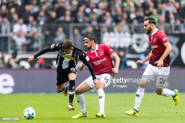 Thorgan Hazard of Borussia Monchengladbach Martin Harnik of Hannover 96 Kenan Karaman of Hannover 96 during the Bundesliga match between Borussia...