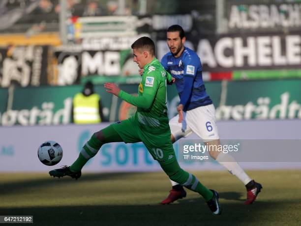 Thorgan Hazard of Gladbach and Mario Vrancic of Darmstadt battle for the ball during the Bundesliga match between SV Darmstadt 98 and Borussia...