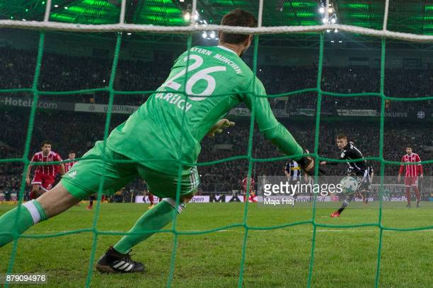 Thorgan Hazard of Moenchengladbach about to take a penally past Sven Ulreich of Bayern Muenchen that results in a goal to make it 10 during the...