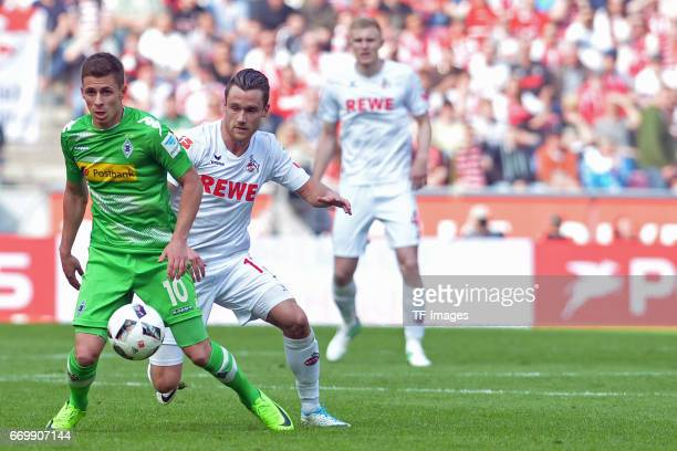 Thorgan Hazard of Moenchengladbach and Christian Clemens of Koeln battle for the ball during the Bundesliga Match between 1FC Koeln and Borussia...