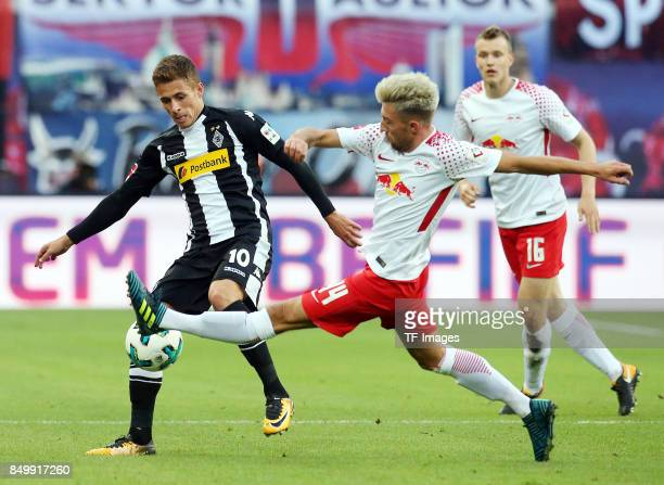 Thorgan Hazard of Moenchengladbach and Kevin Kampl of Leipzig battle for the ball during the Bundesliga match between RB Leipzig and Borussia...