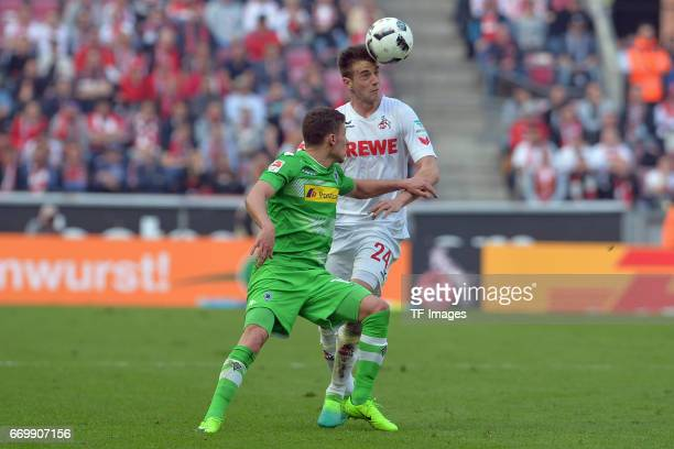 Thorgan Hazard of Moenchengladbach and Lukas Kluenter of Koeln battle for the ball during the Bundesliga Match between 1FC Koeln and Borussia...