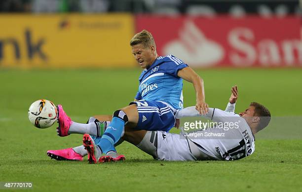 Thorgan Hazard of Moenchengladbach and Matthias Ostrzolek of Hamburg battle for the ball during the Bundesliga match between Borussia...