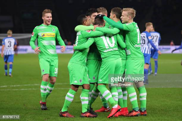 Thorgan Hazard of Moenchengladbach celebrates wit his team after he scored a penalty goal to make it 02 during the Bundesliga match between Hertha...
