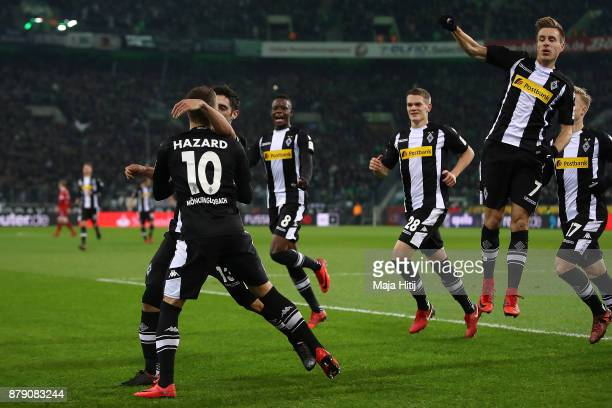 Thorgan Hazard of Moenchengladbach celebrates with his team mates after he scored to make it 10 during the Bundesliga match between Borussia...