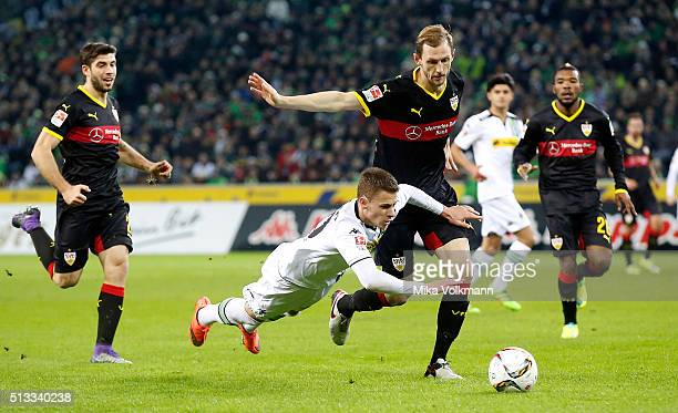 Thorgan Hazard of Moenchengladbach clashes with Georg Niedermeier of Stuttgart during the Bundesliga match between Borussia Moenchengladbach and VfB...