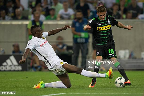 Thorgan Hazard of Moenchengladbach is challenged by Denis Zakaria during the UEFA Champions League Qualifying PlayOffs Round Second Leg between...