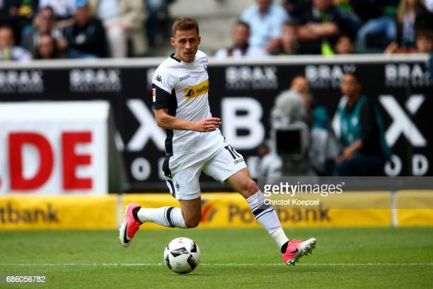 Thorgan Hazard of Moenchengladbach runs with the ball during the Bundesliga match between Borussia Moenchengladbach and SV Darmstadt 98 at...