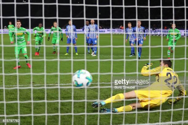 Thorgan Hazard of Moenchengladbach scores a goal from he penalty spot past Rune Jarstein of Berlin to make it 02 during the Bundesliga match between...