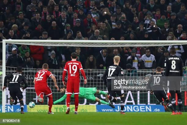 Thorgan Hazard of Moenchengladbach scores a penalty goal to make it 10 during the Bundesliga match between Borussia Moenchengladbach and FC Bayern...