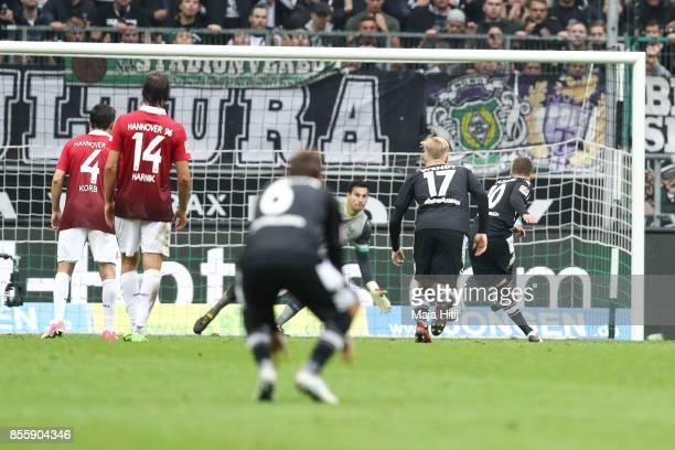 Thorgan Hazard of Moenchengladbach scores penalty shot to make it 21 during the Bundesliga match between Borussia Moenchengladbach and Hannover 96 at...