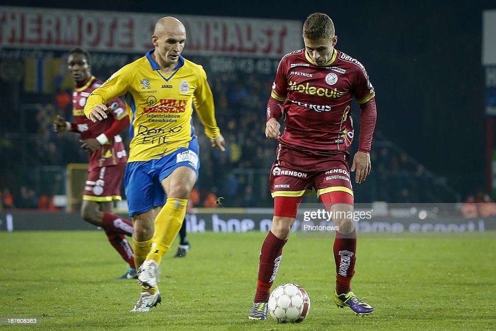 Thorgan Hazard of Zulte Waregem and Milos Maric of Waasland Beveren during the Jupiler Pro League match between Zulte Waregem and Waasland Beveren on November 10, 2013 in Waregem, Belgium.