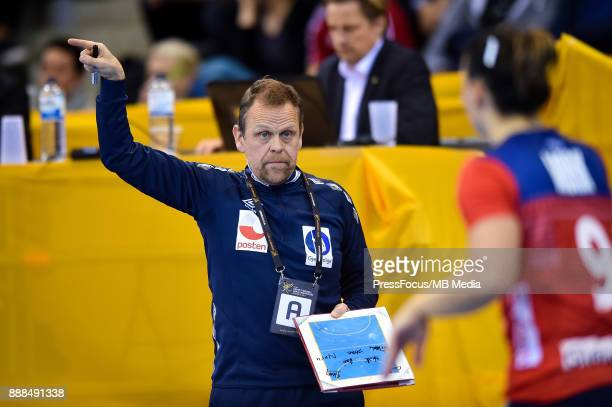Thorir Hergeirsson head coach of Norway give pointers to Nora Mork of Norway during IHF Women's Handball World Championship group B match between...