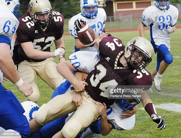 Thornton Academy's Nick Kenney drives downfield against Kennebunk Friday Sept 3 2010