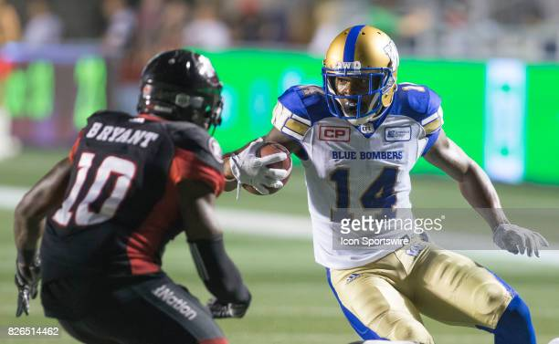 J Thorpe of the Winnipeg Blue Bombers dodges and weaves against the Ottawa Redblacks in Canadian Football League action at TD Place Stadium in Ottawa...