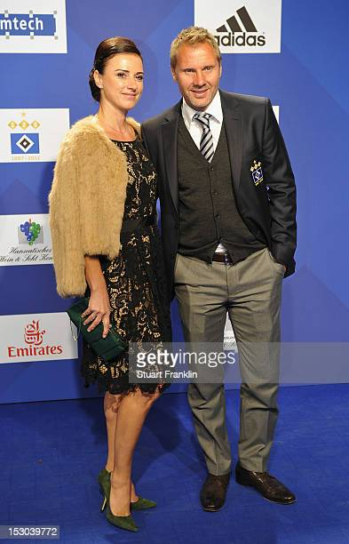 Thorsten Fink head caoch of Hamburg and his wife Silke Fink pose for a picture on the blue carpet prior to the Hamburger SV 125th anniversary gala at...