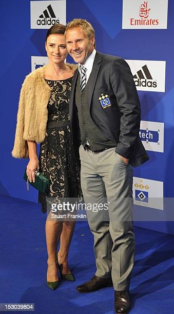 Thorsten Fink head coach of Hamburg and his wife Silke Fink pose for a picture on the blue carpet prior to the Hamburger SV 125th anniversary gala at...
