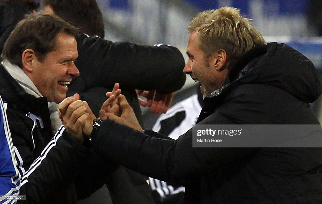 <a gi-track='captionPersonalityLinkClicked' href=/galleries/search?phrase=Thorsten+Fink&family=editorial&specificpeople=2381735 ng-click='$event.stopPropagation()'>Thorsten Fink</a> (R), head coach of Hamburg celebrates with sport director Frank Arnesen (L) after winning the Bundesliga match between Hamburger SV and 1899 Hoffenheim at Imtech Arena on November 20, 2011 in Hamburg, Germany.