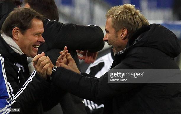 Thorsten Fink head coach of Hamburg celebrates with sport director Frank Arnesen after winning the Bundesliga match between Hamburger SV and 1899...