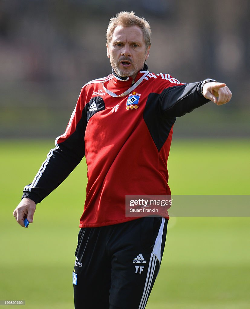 <a gi-track='captionPersonalityLinkClicked' href=/galleries/search?phrase=Thorsten+Fink&family=editorial&specificpeople=2381735 ng-click='$event.stopPropagation()'>Thorsten Fink</a>, head coach of Hamburg gestures during a training session of Hamburger SV on April 18, 2013 in Hamburg, Germany.