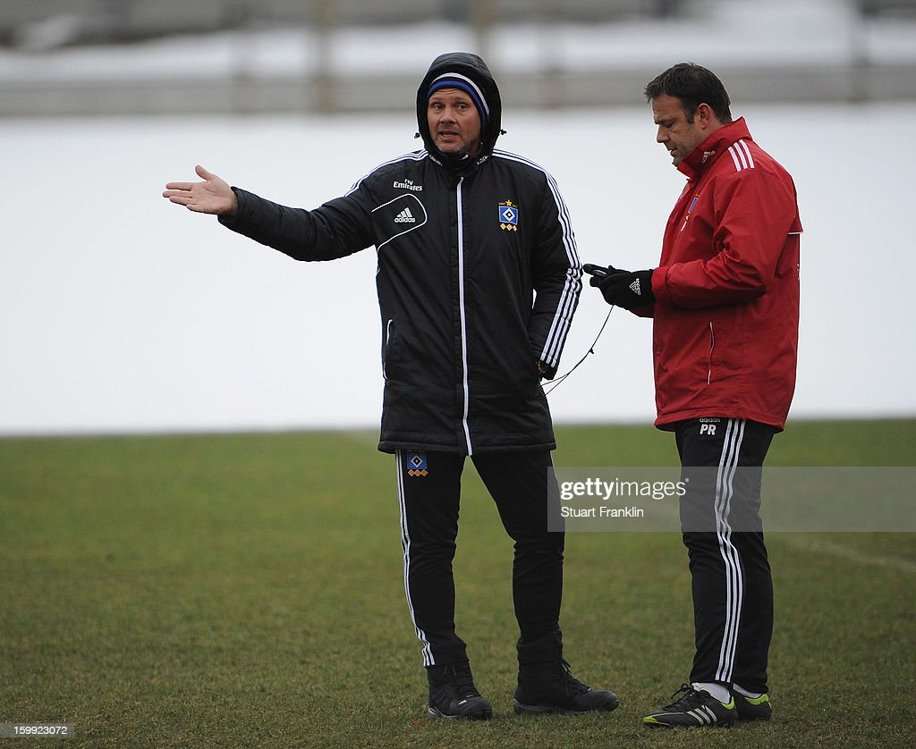 <a gi-track='captionPersonalityLinkClicked' href=/galleries/search?phrase=Thorsten+Fink&family=editorial&specificpeople=2381735 ng-click='$event.stopPropagation()'>Thorsten Fink</a>, head coach of Hamburg gestures with his assitant Patrick Rahmen during a training session of Hamburg SV on January 23, 2013 in Hamburg, Germany.