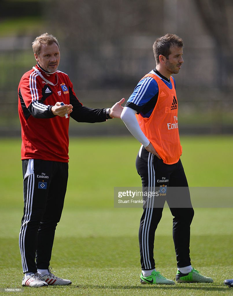 Thorsten Fink, head coach of Hamburg gestures with Rafael van der Vaart during a training session of Hamburger SV on April 18, 2013 in Hamburg, Germany.