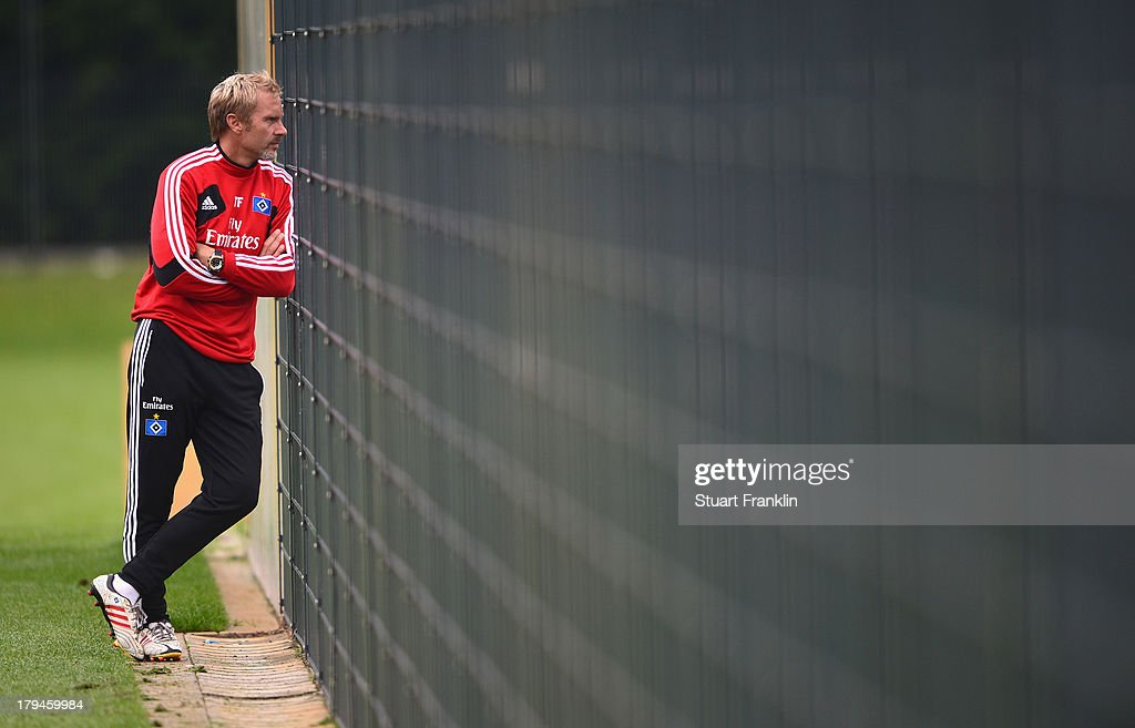 <a gi-track='captionPersonalityLinkClicked' href=/galleries/search?phrase=Thorsten+Fink&family=editorial&specificpeople=2381735 ng-click='$event.stopPropagation()'>Thorsten Fink</a> , head coach of Hamburg ponders during a training session of Hamburger SV on September 4, 2013 in Hamburg, Germany.